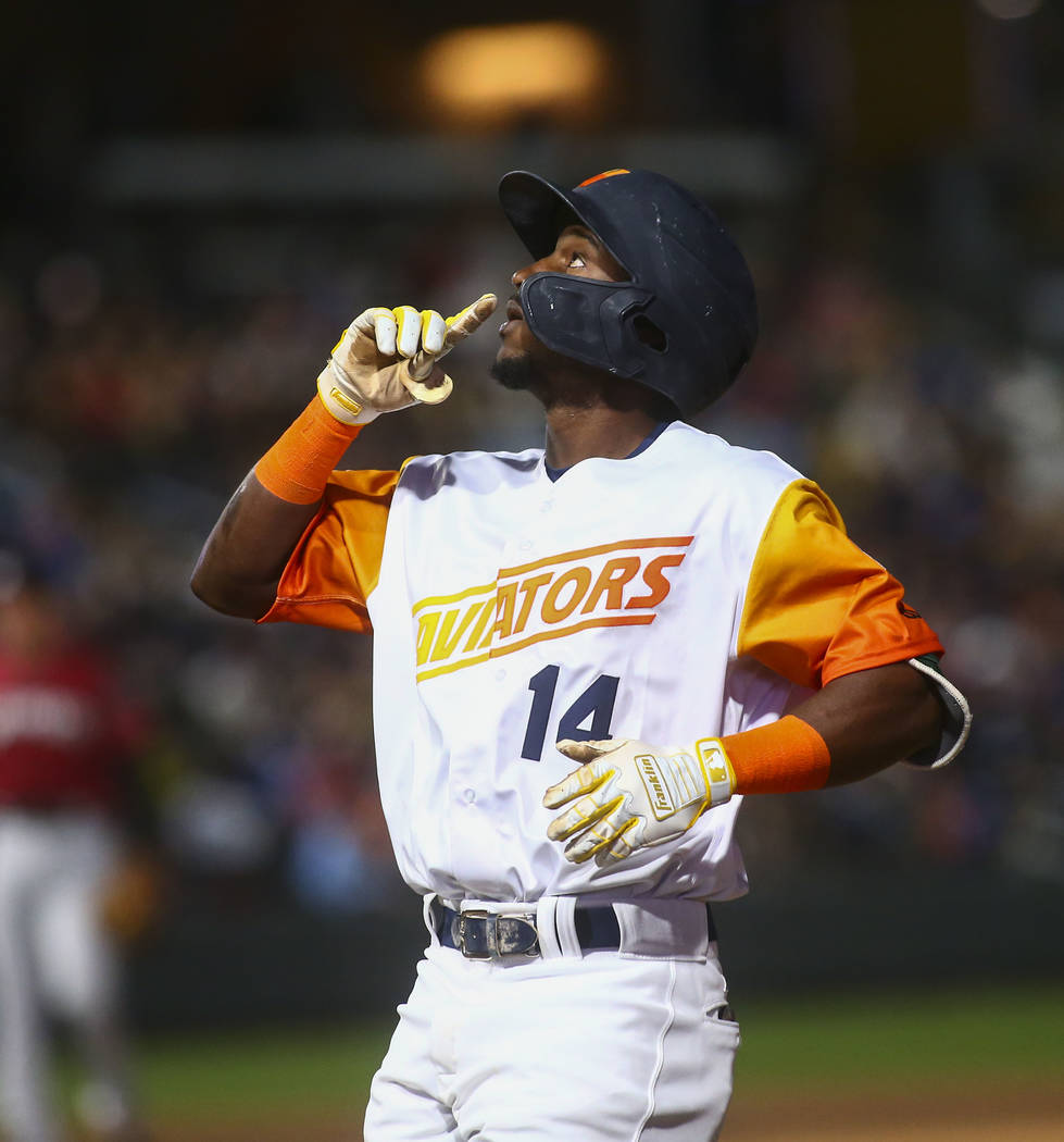 Las Vegas Aviators shortstop Jorge Mateo (14) celebrates at first base after a hit during the f ...