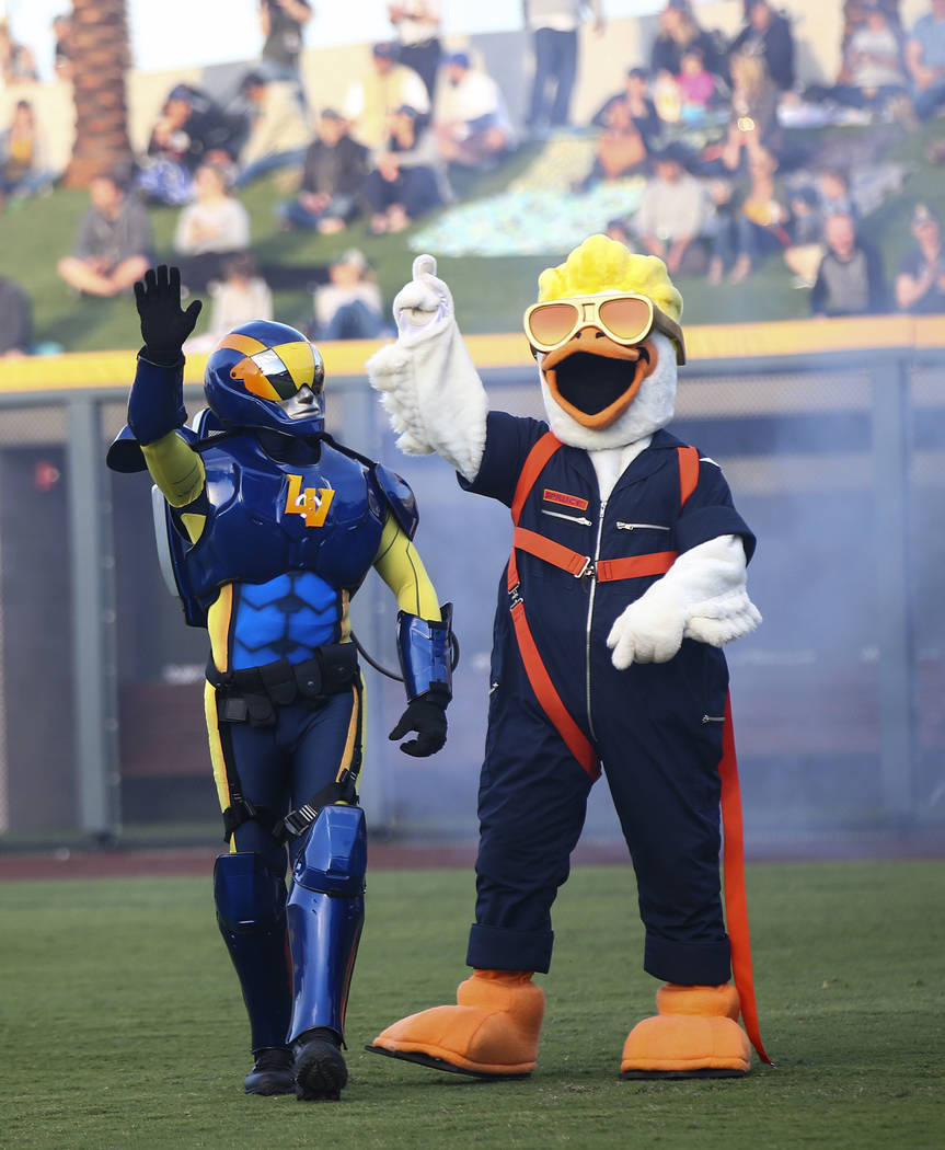 Mascot Spruce the Goose, right, introduces Mr. Aviator before the start of the Las Vegas Aviato ...
