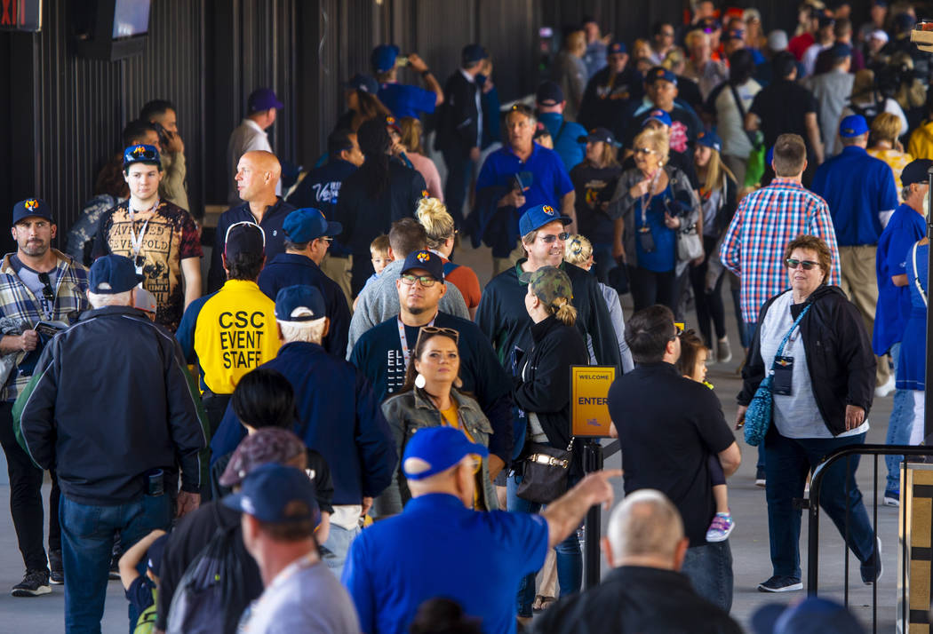Fans stream along inside the ballpark before the Las Vegas Aviators home opener on Tuesday, Apr ...