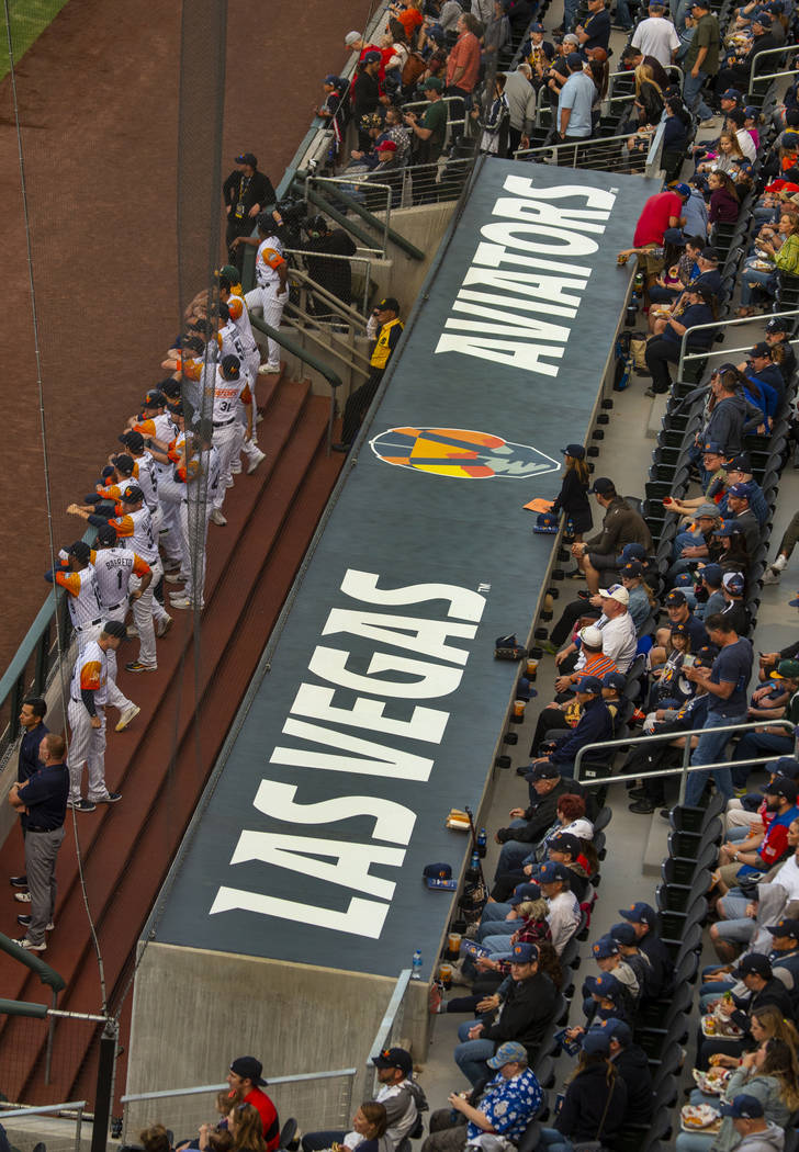 The team awaits on the rail before the Las Vegas Aviators home opener on Tuesday, April 9, 2019 ...