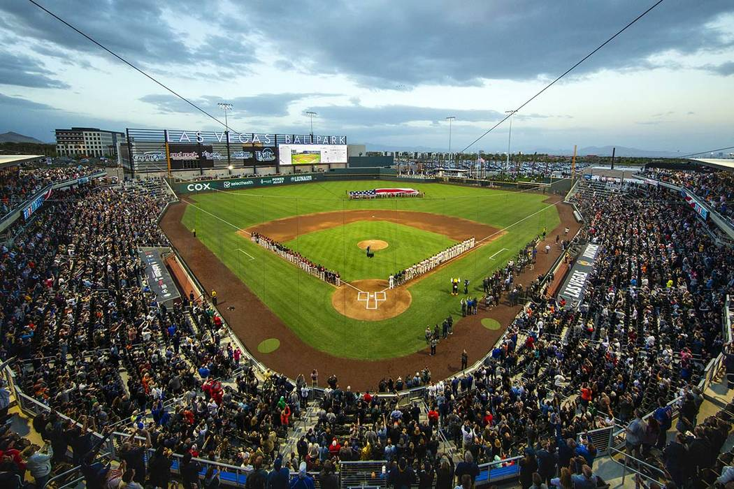 The American flag is unfurled for the national anthem at the Las Vegas Aviators home opener at ...