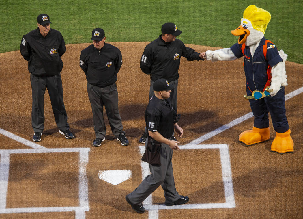 Umpires meet at home plate and are greeted by Spruce before the start of the Las Vegas Aviators ...