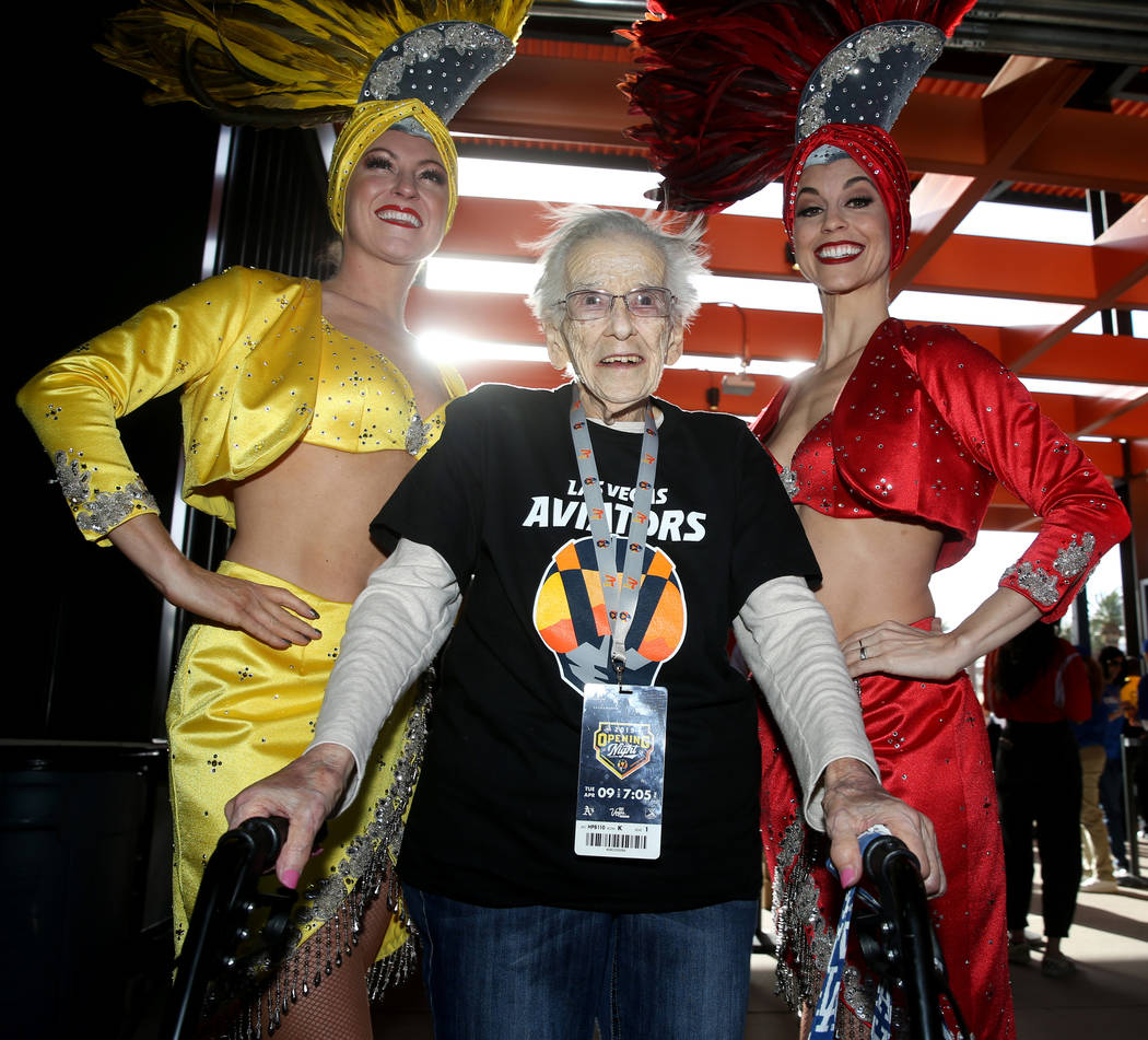 Valeria Greene, 95, of Las Vegas poses with showgirls Jen Vossmer, left, and Brooke Brown after ...
