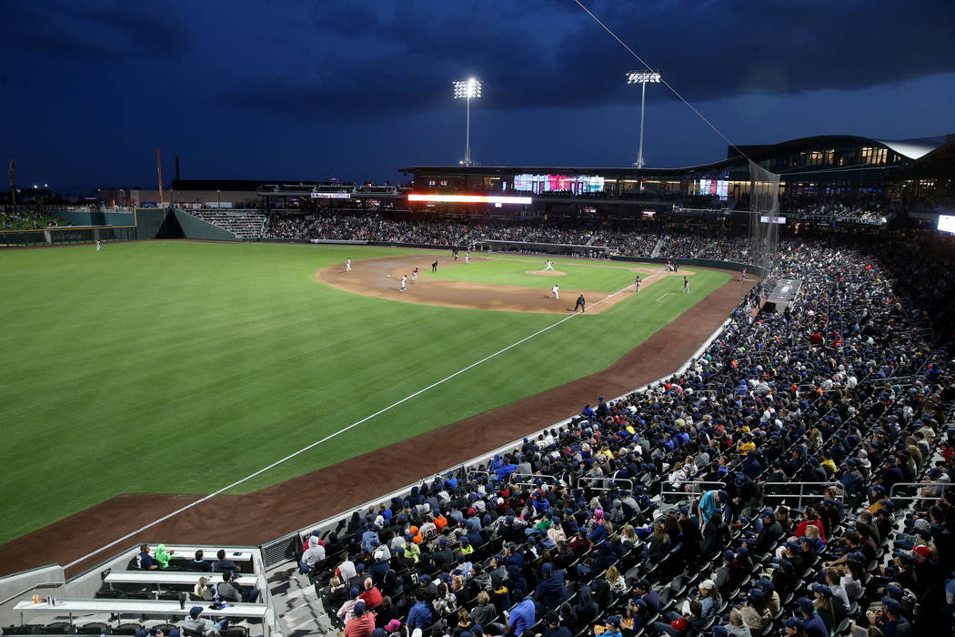 Fans watch the action on the first-ever opening night for the Las Vegas Aviators at Las Vegas B ...