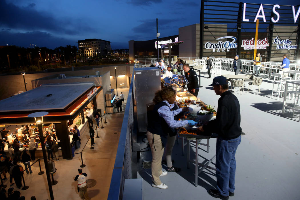 Fans grab food on the first-ever opening night for the Las Vegas Aviators at Las Vegas Ballpark ...