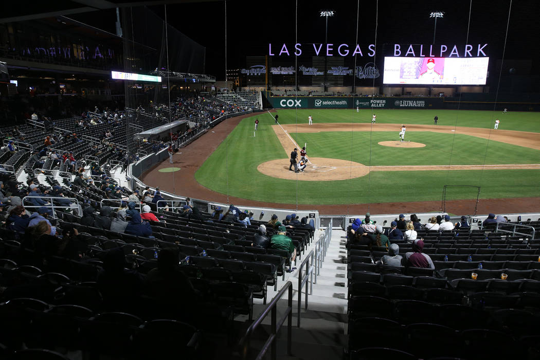 Fans take in the action during the fourth inning on opening night for the Las Vegas Aviators at ...