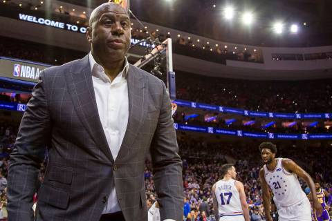 "Los Angeles Lakers' President of basketball operations Earvin ""Magic"" Johnson looks o ..."