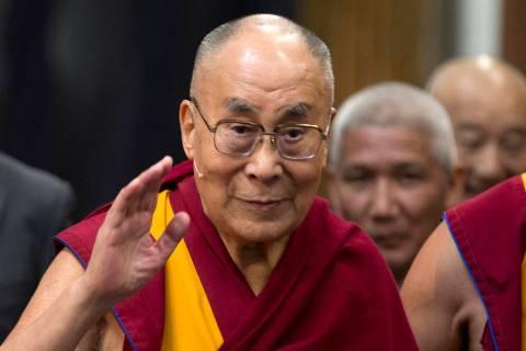 In this Sept. 15, 2018, file photo, Tibetan spiritual leader the Dalai Lama greets journalists ...