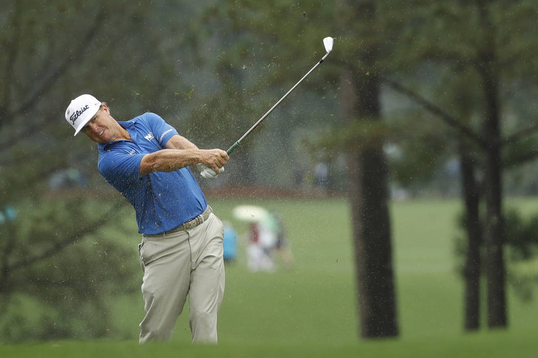 Charley Hoffman hits from the fairway in the rain on the first hole during a practice round for ...