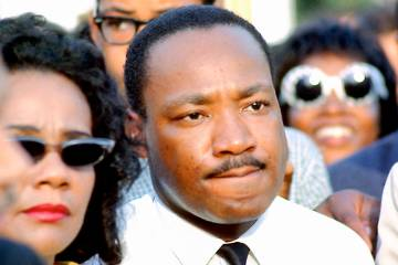 Martin Luther King Jr. and his wife, Coretta Scott King, are seen July 10, 1966, in Chicago's G ...