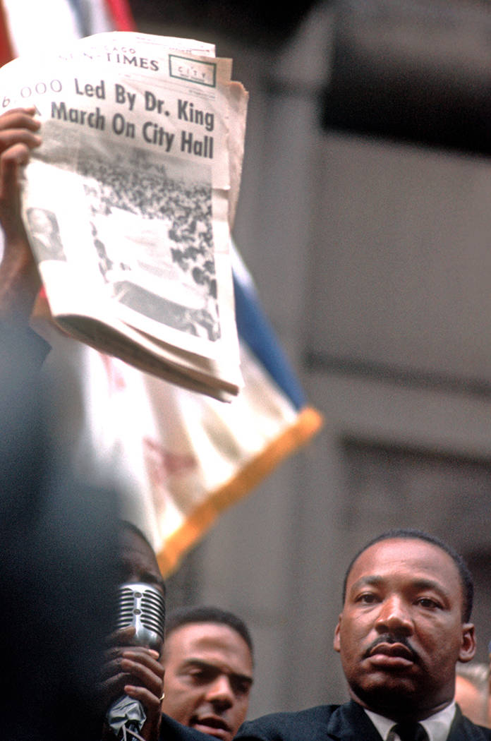 Martin Luther King Jr. and Andrew Young are seen at a rally July 24, 1965, at Chicago City Hall ...