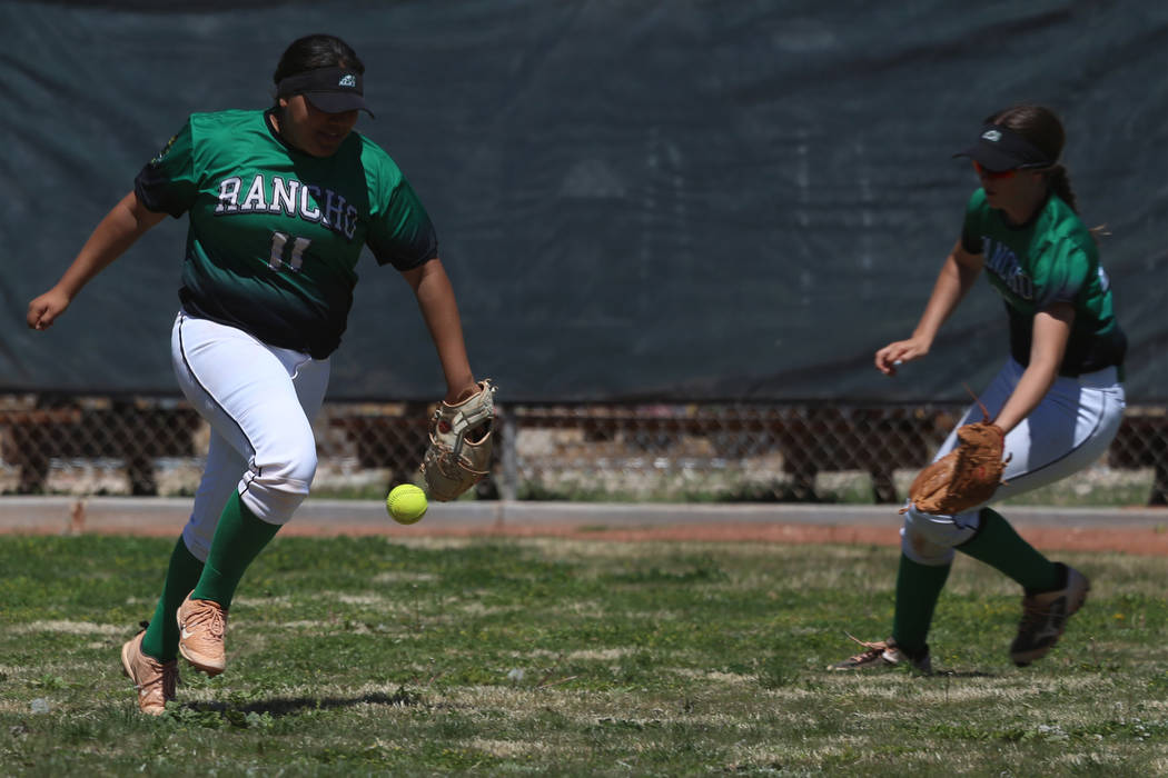 Ranchos' Mia Elicerio (11) watches as the ball falls in the outfield for a Desert Oasis single ...