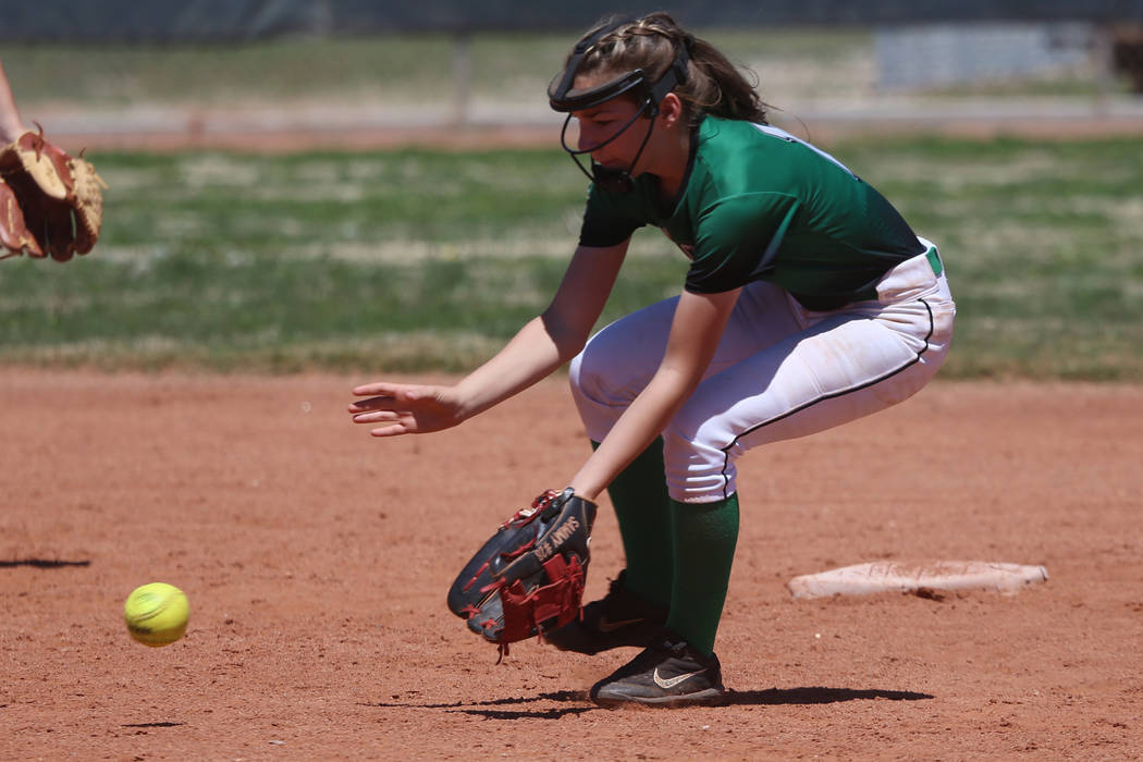Rancho's Samantha Whalen (10) picks up a ground ball against Desert Oasis in the softball game ...