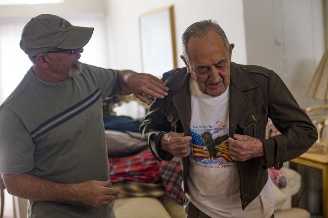 "John Zacari helps his father Onofrio ""No-No"" Zicari put on his jacket from when he wa ..."