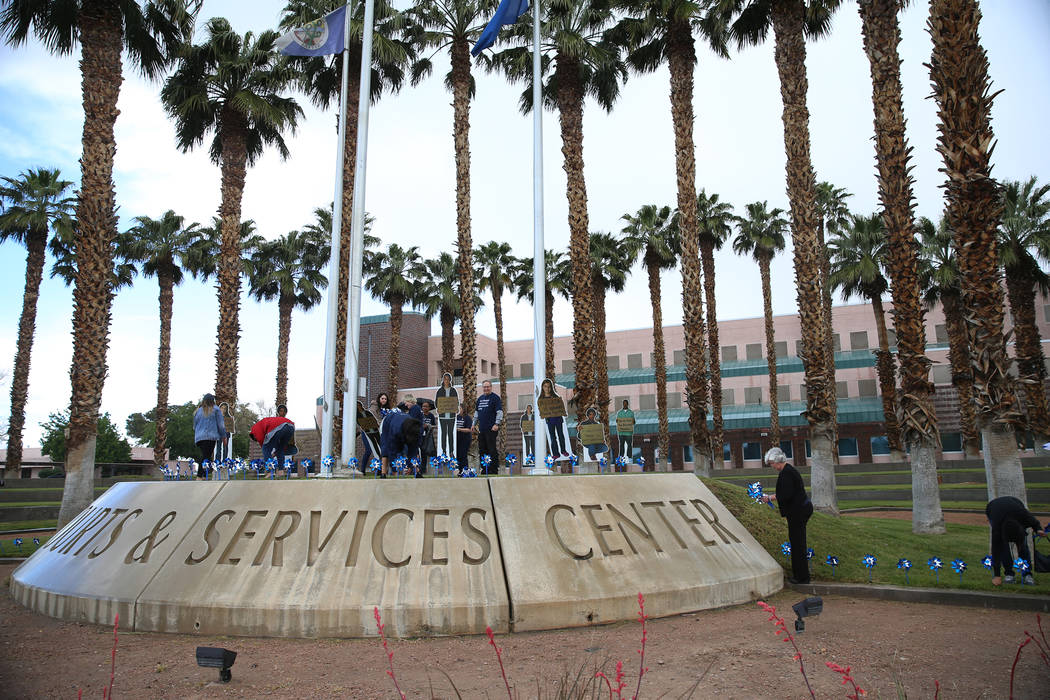Volunteers plant 450 pinwheels outside of the Eighth Judicial District Family Court in Las Vega ...