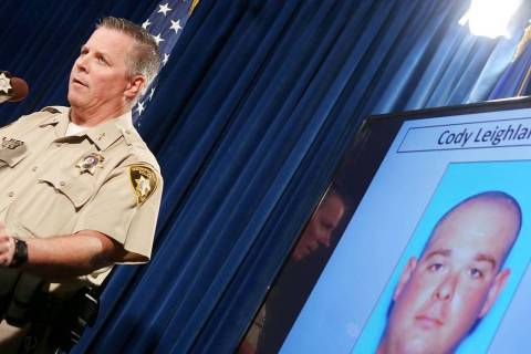 Assistant Clark County Sheriff Todd Fasulo shows a photo of Cody Leighland O'Bryan on Sept. 28, ...