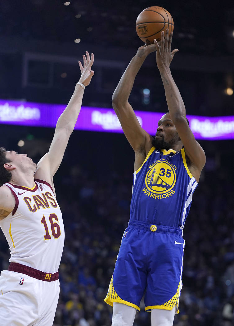 Golden State Warriors forward Kevin Durant (35) shoots over Cleveland Cavaliers forward Cedi Os ...