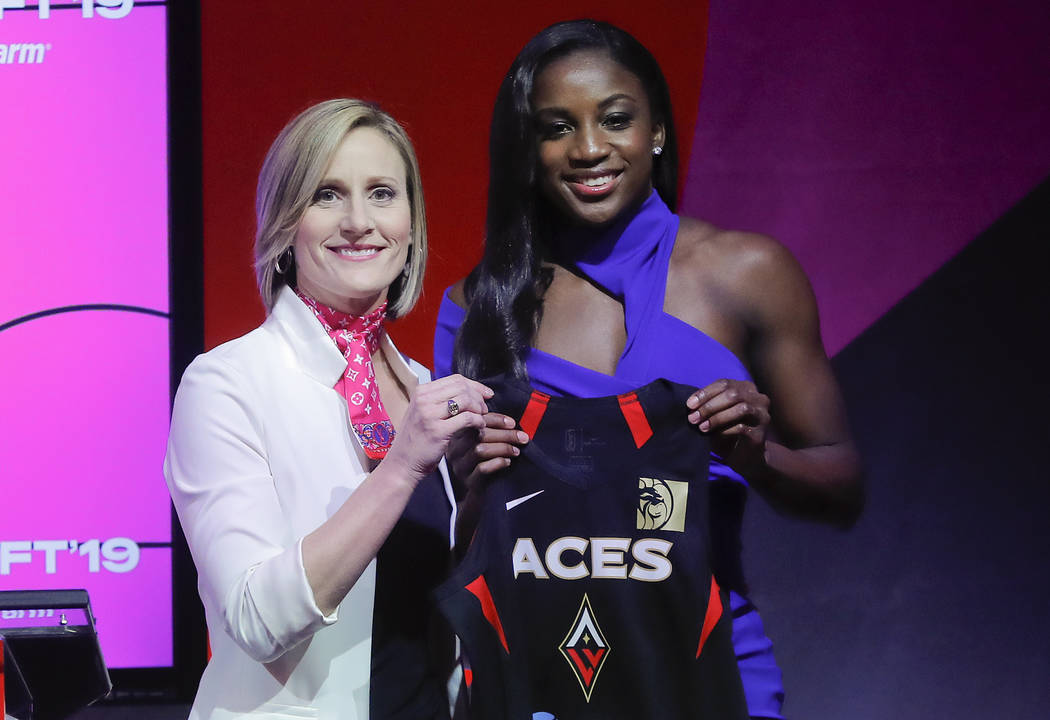 Notre Dame's Jackie Young, right, poses for a photo with WNBA COO Christy Hedgpeth after being ...