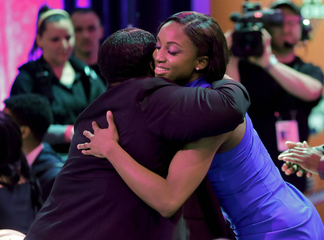 Notre Dame's Jackie Young hugs a relative after being selected by the Las Vegas Aces as the num ...