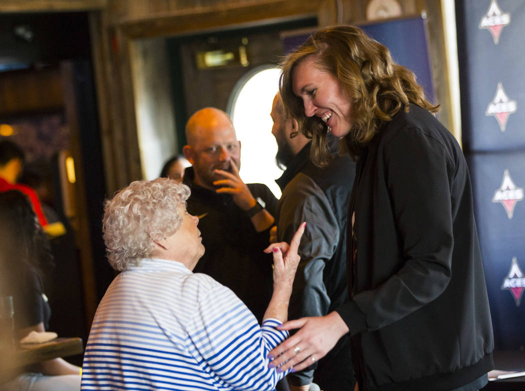 Las Vegas Aces player Carolyn Swords, right, talks with Jan Jones during a watch party for the ...