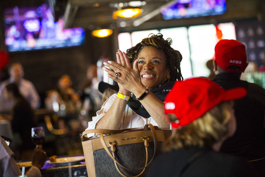 Las Vegas Aces fan Karmen Miller celebrates after Jackie Young of Notre Dame was selected as th ...