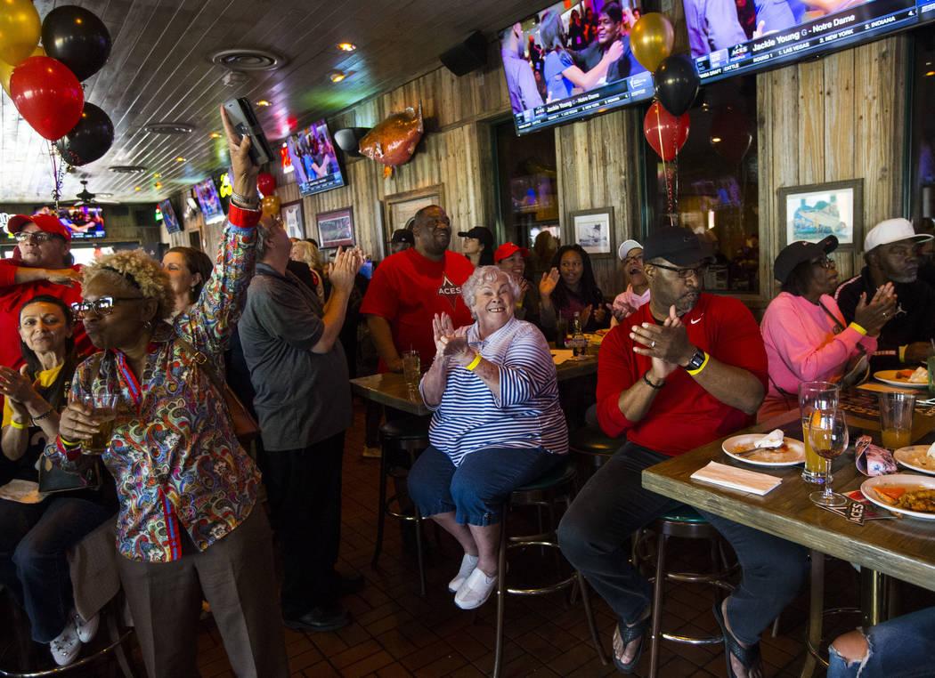 Las Vegas Aces fans, including Jan Jones, center, celebrate after Jackie Young of Notre Dame wa ...