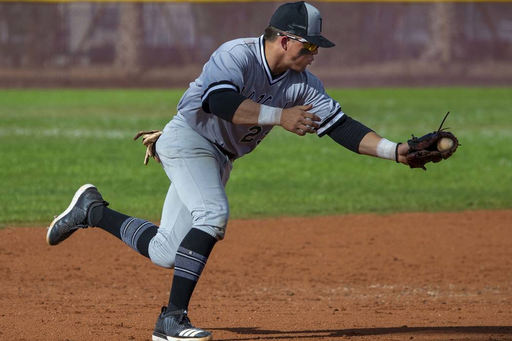 Palo Verde's Paul Myro IV (23) scoops up a grounder from a Faith lutheran batter during their h ...