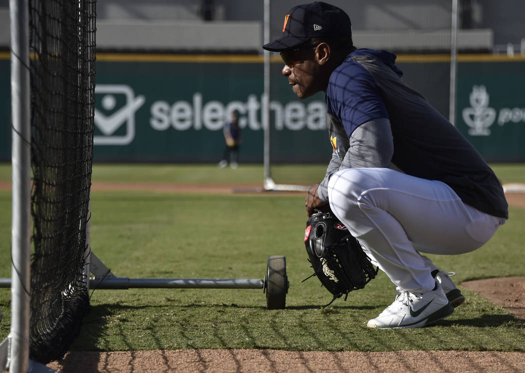 Retired Major League baseball player and now special coach Rickey Henderson works with the Las ...