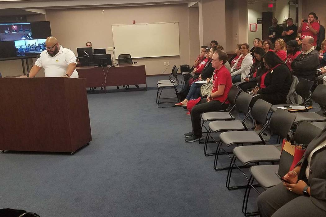 Alber Mora, a baker at Caesars Palace, addresses the state Gaming Control Board in Carson City ...