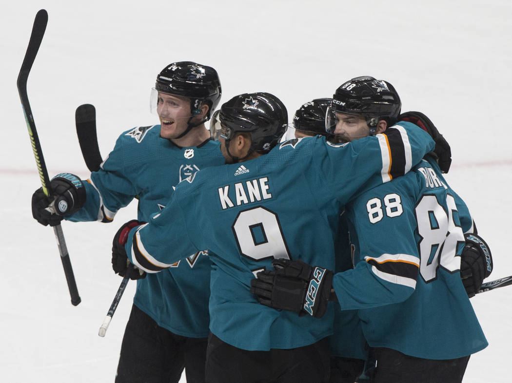 San Jose Sharks left wing Evander Kane (9) celebrates with teammate defenseman Brent Burns (88) ...
