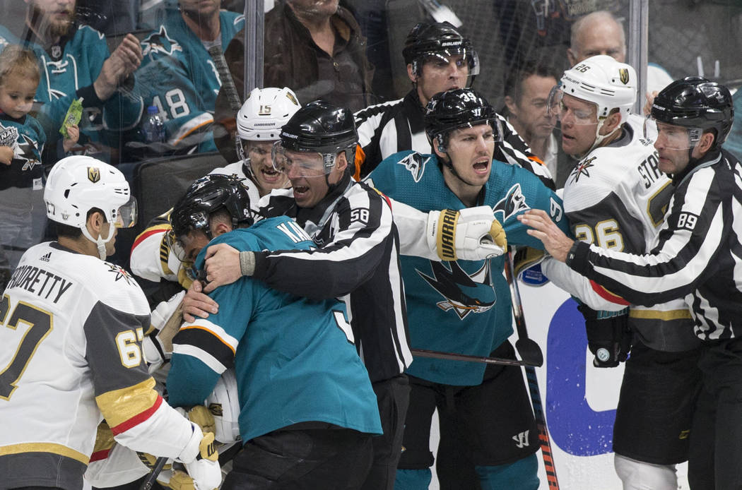 The Golden Knights and San Jose Sharks fight in the first period during game one of the NHL Wes ...
