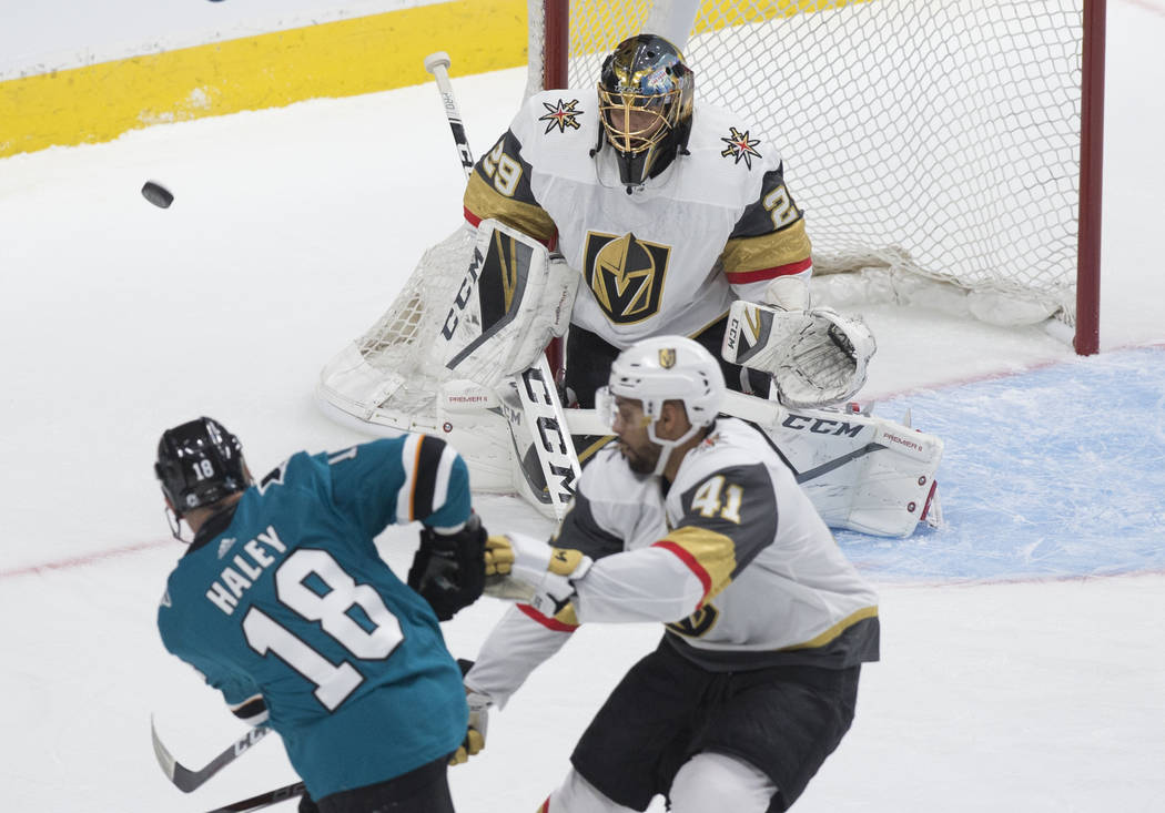 Golden Knights goaltender Marc-Andre Fleury (29) makes a save against San Jose Sharks center Mi ...