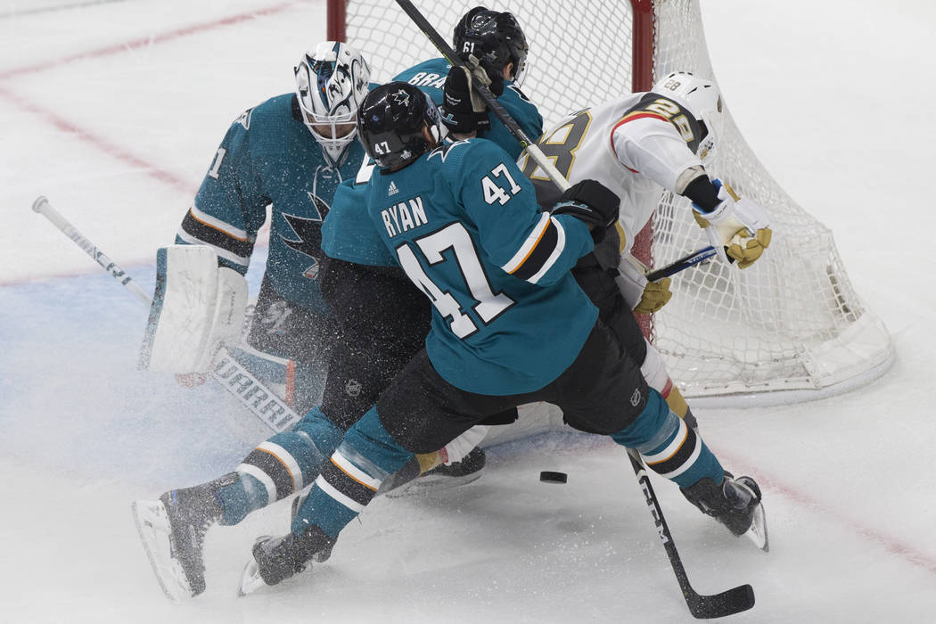 San Jose Sharks goaltender Martin Jones (31) makes a save against Golden Knights left wing Will ...