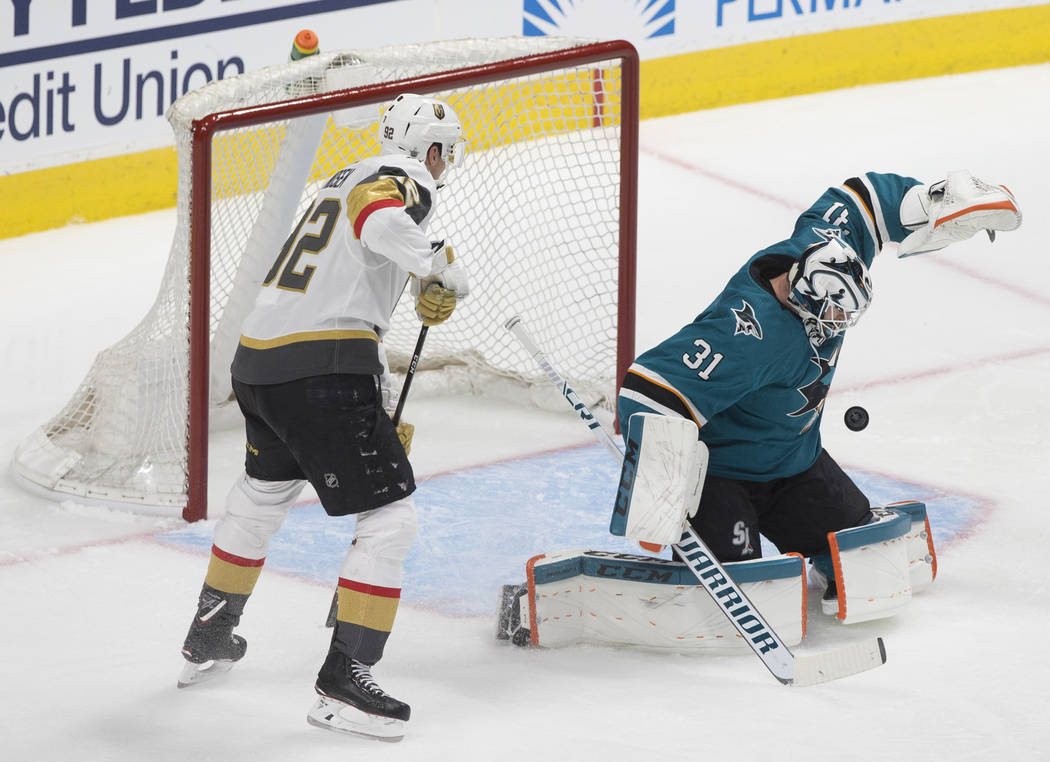 San Jose Sharks goaltender Martin Jones (31) makes a save against Golden Knights left wing Toma ...