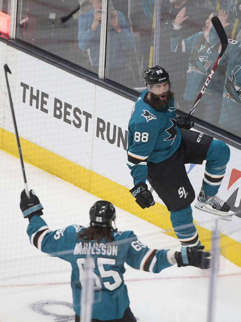 San Jose Sharks defenseman Brent Burns (88) celebrates with teammate Erik Karlsson (65) after s ...