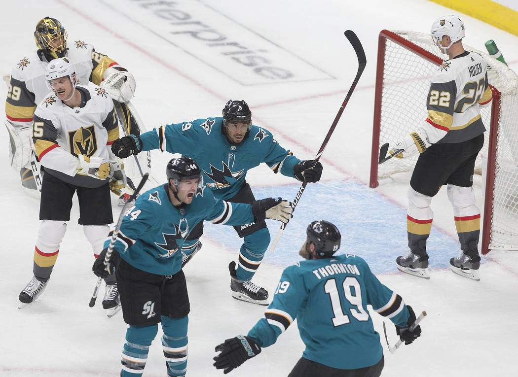 San Jose Sharks defenseman Marc-Edouard Vlasic (44) celebrates with teammates Joe Thornton (19) ...