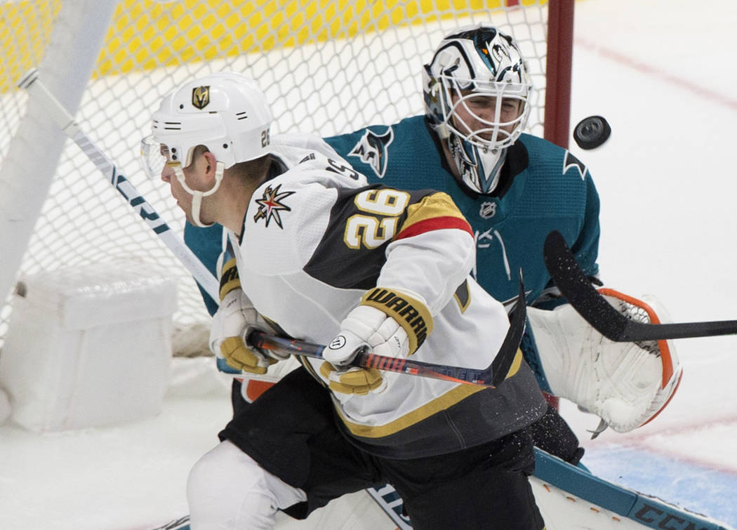 San Jose Sharks goaltender Martin Jones (31) makes a save against Golden Knights center Paul St ...