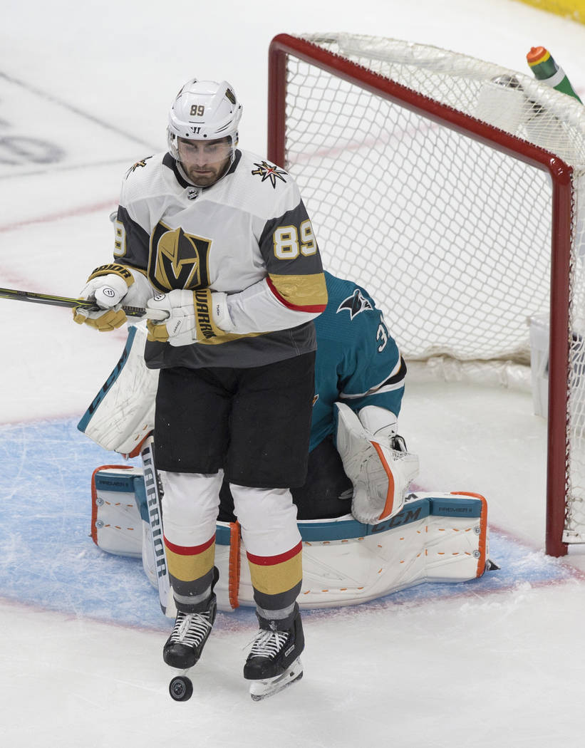 Golden Knights right wing Alex Tuch (89) leaps to get out of the way of the puck in front of Sa ...