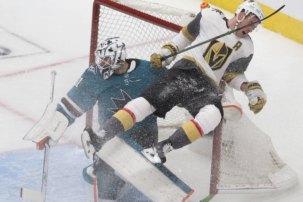 Golden Knights right wing Reilly Smith (19) collides with San Jose Sharks goaltender Martin Jon ...