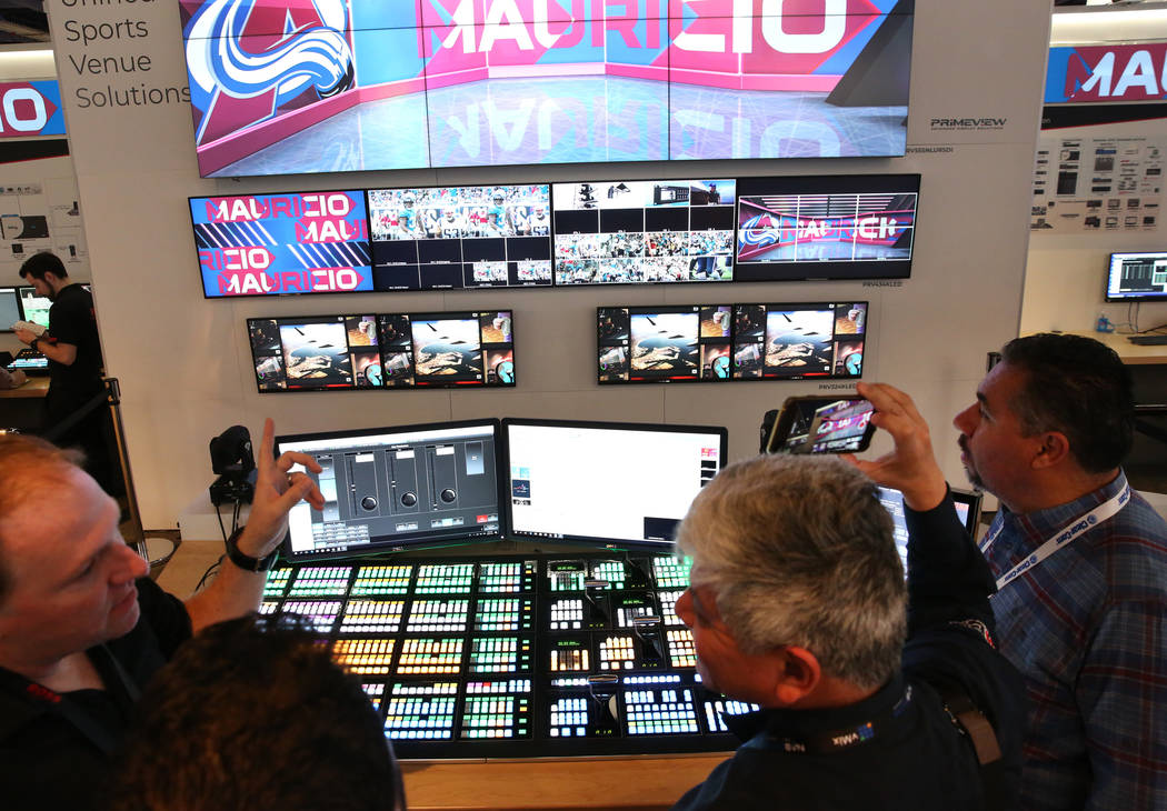 Shawn Hutchinson, left, of Ross Video talks about his product, AWA Tessera, a multi-display rea ...
