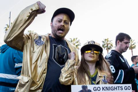 Golden Knights fans Brad Ellis, left, and daughter Madeline, 11, cheer for Vegas outside the SA ...
