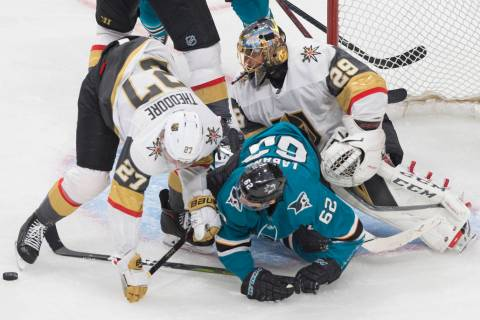 Golden Knights goaltender Marc-Andre Fleury (29) makes a save against San Jose Sharks right win ...