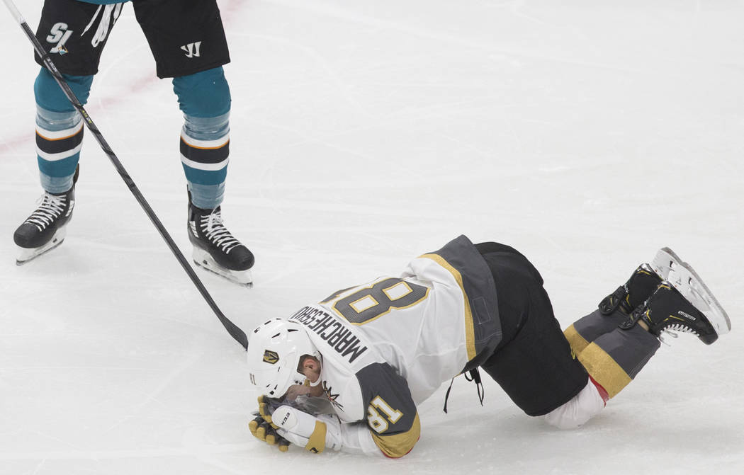 Golden Knights center Jonathan Marchessault (81) holds his face after getting hit by San Jose S ...