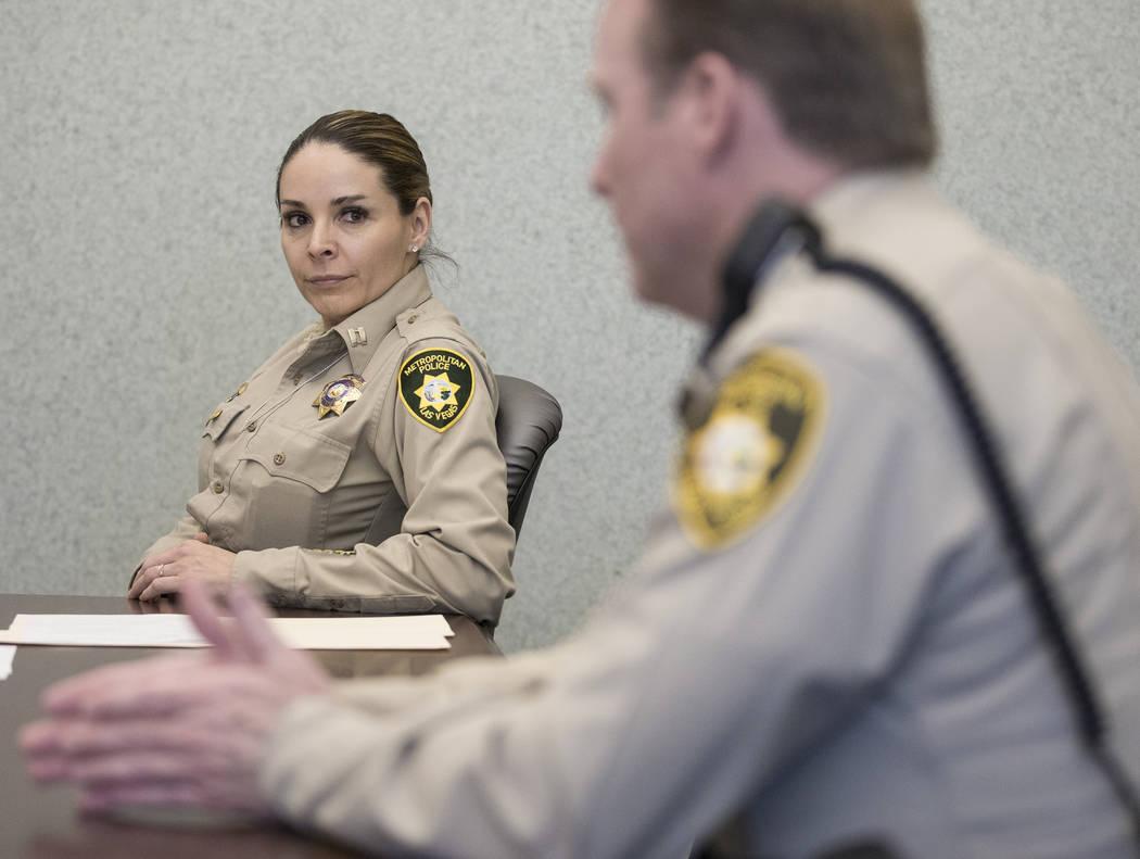 Metropolitan Police Department Capt. Sasha Larkin, left, listens to Metropolitan Police Departm ...