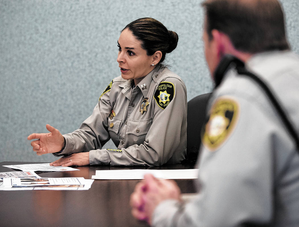 Metropolitan Police Department Capt. Sasha Larkin, left, discusses the issue of stolen guns in ...