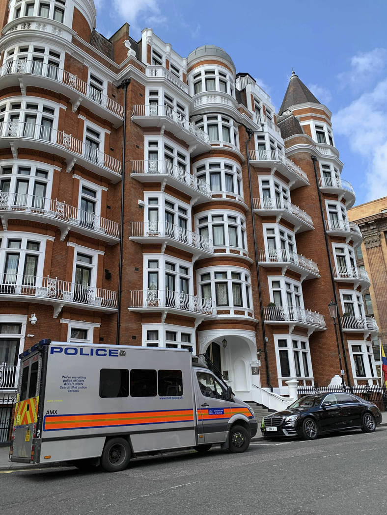 A police van parked outside the Ecuadorian Embassy in London, after WikiLeaks founder Julian As ...