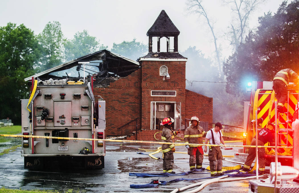 Firefighters and fire investigators respond to a fire at Mt. Pleasant Baptist Church Thursday, ...