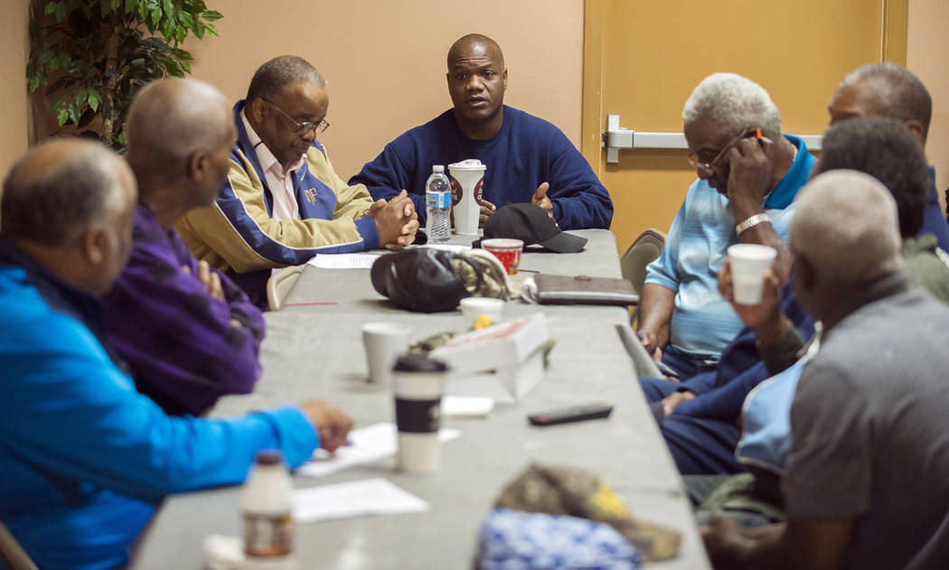 Rev. Kyle Sylvester, center, who pastor's St. Mary Missionary Baptist Church which was the firs ...