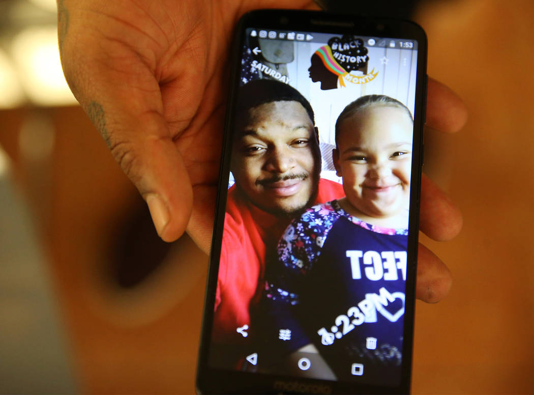 Danaun Davis shows a picture of his daughter La'Rayah, 5, at the Regional Justice Center in Las ...