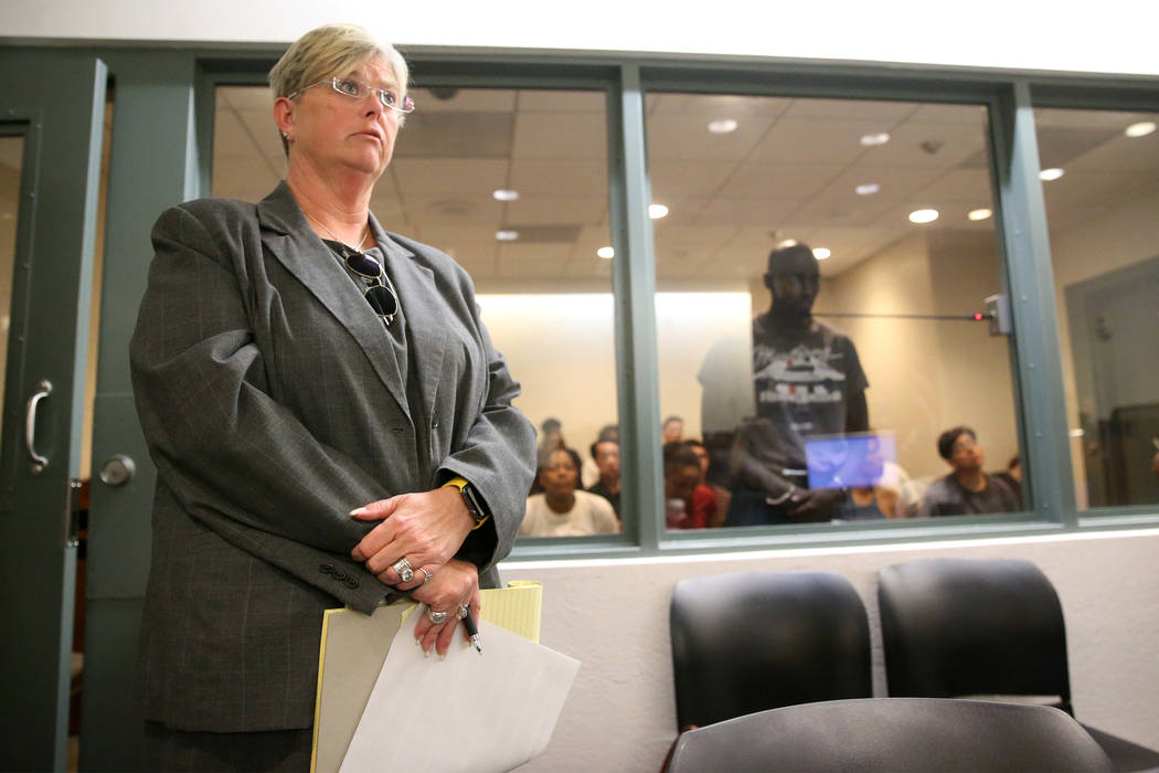 Lauria Lynch-German, left, during the initial court appearance for her client, ex-NFL player Ci ...